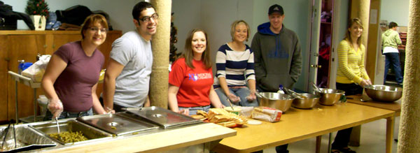 Left to right, Elyse, Mike, Emily, Andi, Brad, Lindsey, and Aggi in the kitchen.