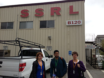 Elyse, Aaron, and Aggi outside Building 120 for safety training.